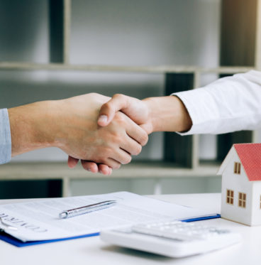 signing contract buying home